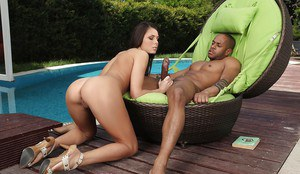 Sexy brunette female Melanie Memphis giving BBC ball licking blowjob by pool