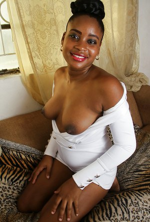 Ebony solo girl Amber releasing saggy boobs and pink pussy from clothing