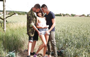 Young girl Suzy Rainbow having sex with 2 guys in marshy wetlands