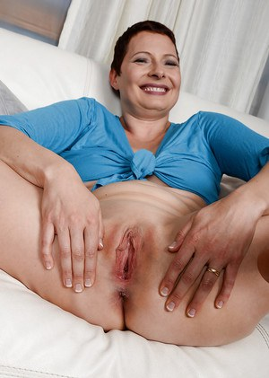 Older woman Kali Karinena pulling down shorts and stretching labia lips