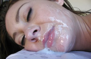 Pretty female Jessica Valentino drizzling cum from mouth after blowing masseur