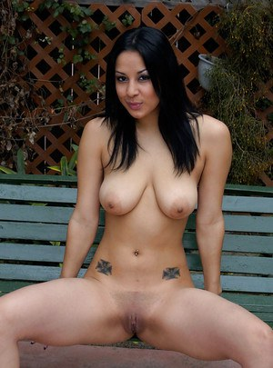 Latina female Paige Taylor letting big natural boobs free in garden