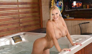 Blonde bombshell Dolly Fox unleashing monster tits before getting in Jacuzzi