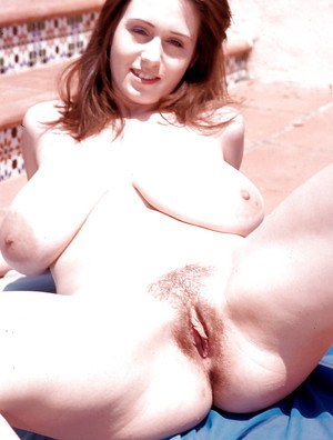 Nicole Peters presents her furry cunt and huge tits in sunny outdoor solo