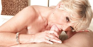 Blonde granny DeAnna Bentley undressed by younger guy for sexual relations