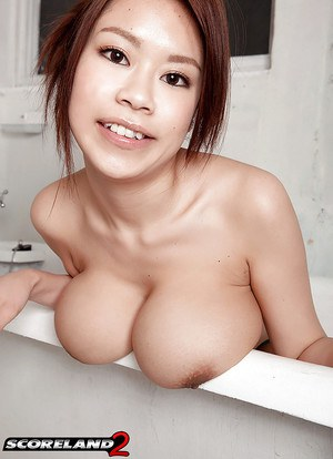 Kinky Asian babe Ria Sakuragi plays an entrancing solo exposing big saggy tits