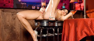 Brunette MILF with fake tits Krista Kaslo plays a foot fetish solo at the bar