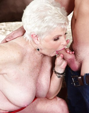 Chubby granny sucks cock of a younger dude and rides it like a real pro