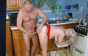 Chunky mature lady Lizzy interrupted for sex while doing kitchen cleaning