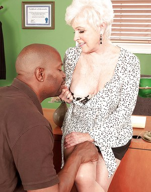 Horny grandma Jewel seducing black man with large cock for sex on desk