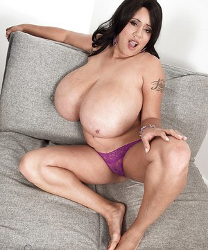 Latina MILF Roxi Red letting monster tits free from purple jumpsuit