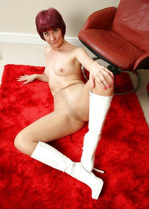 Short haired mature redhead Penny Brooks removing dress and hose to pose nude