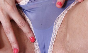 Mature brunette woman Nyla Parker stripping off shorts and blouse