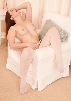 Mature lady Charlotte showing off trimmed snatch in white stockings