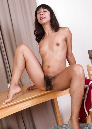 Sexy older Latina Vivi Marie showing off hairy underarms and beaver