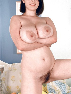 Big boobed Euro chick Nicole Peters inserting vibrator into hairy snatch