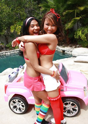 Asian lesbian teens reveal amazing butts and big boobs playing near a pool