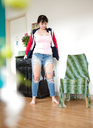 Chubby European amateur Ekaterina dressing herself in ripped blue jeans