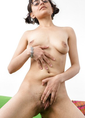 Thin nerd Yasmeena taking off her clothes to display hairy vagina
