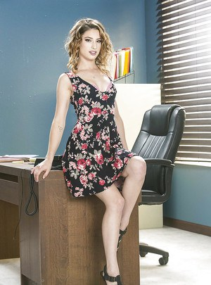 Mischievous office babe Kristen Scott gets naked and plays on the office table
