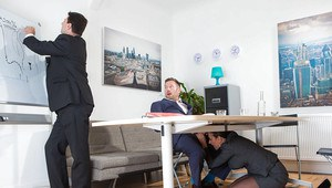 Brunette pornstar Mea goes bitchy in the office sucking a cock under a table