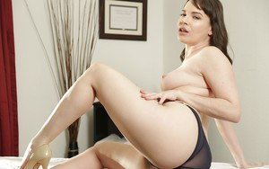 Naked MILF Dana DeArmond bends over to expose a glorious booty and hairy cunt