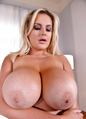 Dirty blonde model Katie Thornton exposing huge tits for centerfold shoot