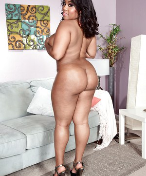 Black BBW Ms Yummy unveiling huge boobs and big booty wearing high heels
