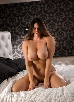 Brunette solo girl Alison Tyler letting hooters loose from bras