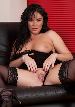 Mature brunette model Danielle Leah Raven unveiling shaved vagina in stockings