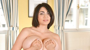 Brunette solo girl Luna Amor unveiling huge all natural boobs and bald cunt