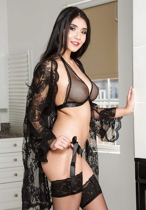 Beautiful dark haired model Brenna Sparks baring bald cunt in black stockings