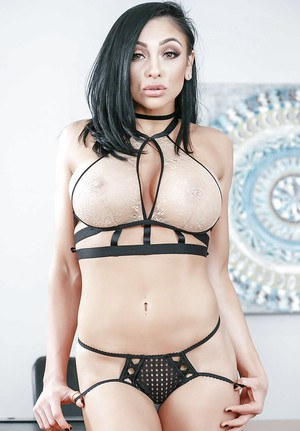 Audrey Bitoni reveals the big tits and shaved peach while at work