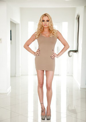 Long legged blond epornstar Briana Banks unveiling big tits to pose naked