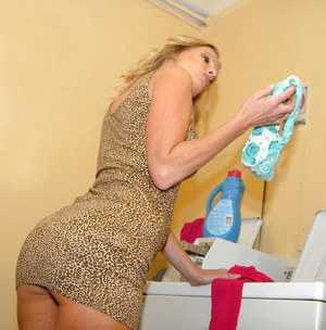 Clothed MILF flashing upskirt panties and pussy on top of dryer