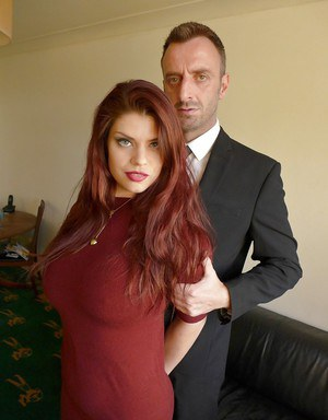 Redhead Euro mom Lucia Love exposing big natural tits and pink pussy