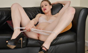 Bare legged amateur model Tina pulling down panties before stretching pussy