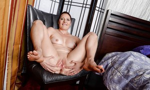 Mature fatty Kali Karinena gets completely naked in the office showing pussy