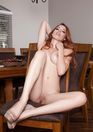 Busty redhead model Caitlin McSwain showing off phat ass and great legs