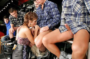 Chick with a hungry mouth gets involved into a dirty group blowbang action