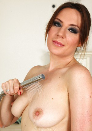 Cheerful babe Samantha Bentley soaps and teases hairy pussy in a bath