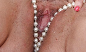 MILF fatty Nyla Parker shoves her beads into her horny hairy pussy