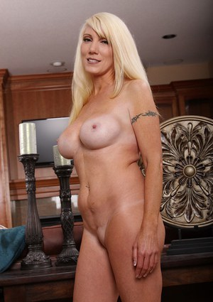 Eye-catching blonde MILF Krystal Day boasts of her big fake tits and bald twat