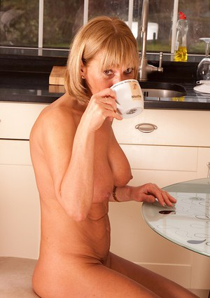Older lady Elaine stripping down to boots at kitchen table