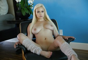 Blonde stunner Kylie Page exposing large natural boobs in leg warmers