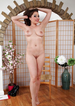 Appealing European babe Sophia Delane likes to pose naked staying on her knees