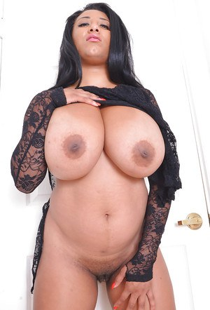 Ebony amateur babe with a plump body reveals big masive tits and black twat