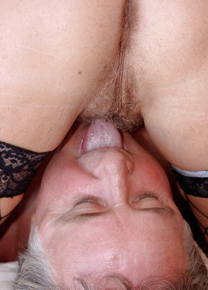 Mature hottie in fishnet stockings gets her hairy beaver licked and screwed
