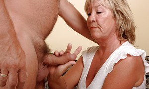 Middle-aged plumper Lizzie and hubby satisfying carnal desires on sofa