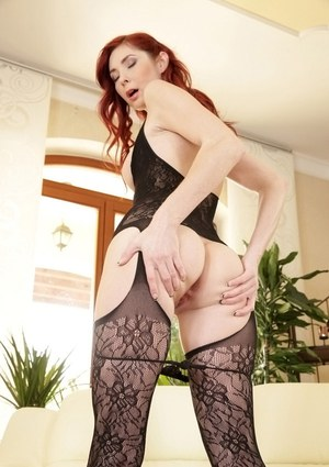 Stunning European redhead Kattie Gold spreads thighs and teases pink pussy